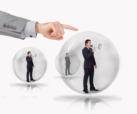 Three businessmen standing in bubble with megaphone with hand about to burst bubble photo