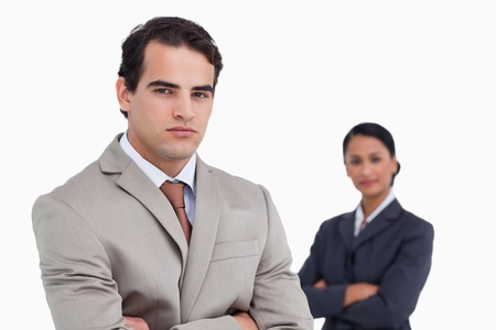 Serious salesman with colleague behind him against a white background Stock Photo - 18679348