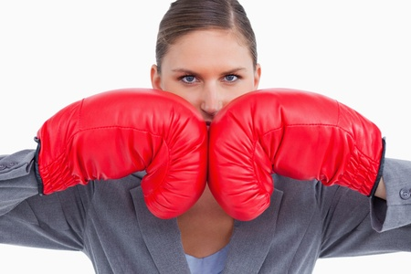 Aggressive tradeswoman with boxing gloves against a white background photo