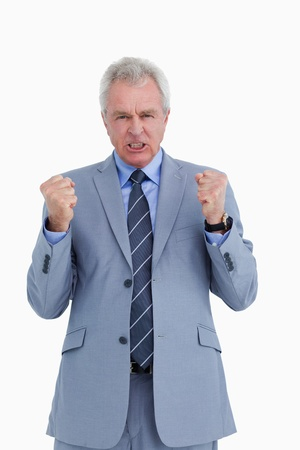 Triumphant mature tradesman against a white background photo