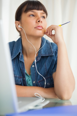 demotivated: Student devolved to do her homework while listening music