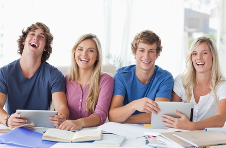 A group of students work together and use tablet pc's to help them Stock Photo - 16056167