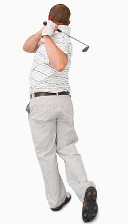 Rear view of golfer against a white background photo