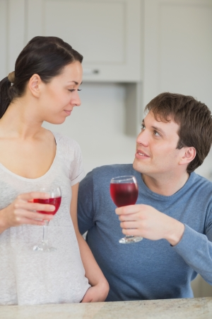 Happy couple with red wine in kitchen Stock Photo - 16054293