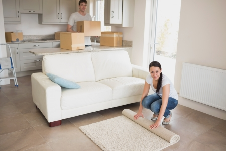 Two people moving into their house and furnishing the kitchen and living room photo