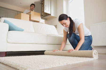Two young relocating people moving into their house and furnishing the lounge Stock Photo - 16052678