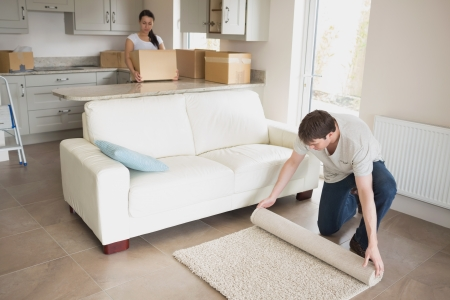 Two young people furnishing the kitchen and living room while relocating Stock Photo - 16055566