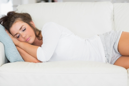 Girl taking nap on sofa photo