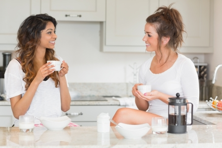 Friends having coffee at breakfast in kitchen Stock Photo - 16055970