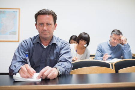Man looking up from class in college photo