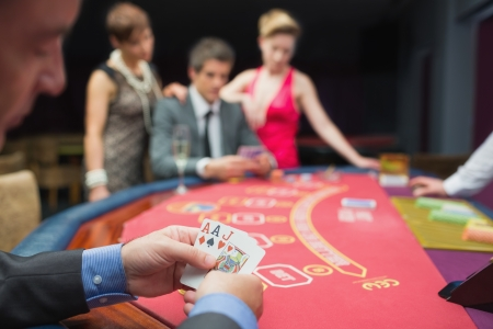 Man has good hand at poker game in casino Stock Photo - 16056672