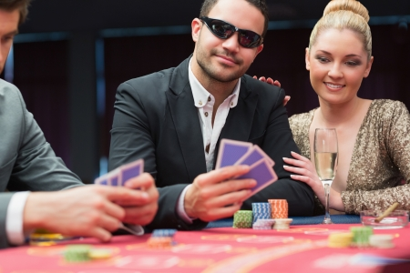 Couple at the poker table in casino photo