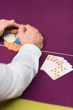 Man sitting grabbing chips close-up Stock Photo - 16056973