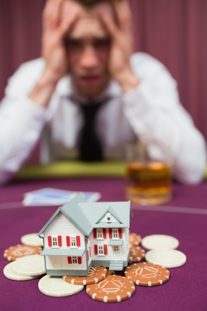 risking: Man risking his house at poker game in casio Stock Photo