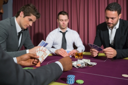 Men at the poker table in the casino Stock Photo - 16079403