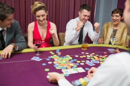 People winning in poker game in casino Stock Photo - 16076513