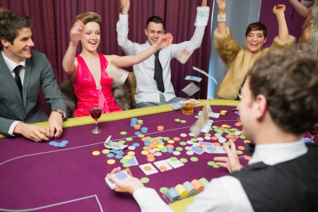 People sitting celebrating at poker game in casino Stock Photo - 16076523