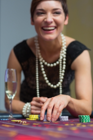 Woman laughing while sitting at table in casino Stock Photo - 16068282