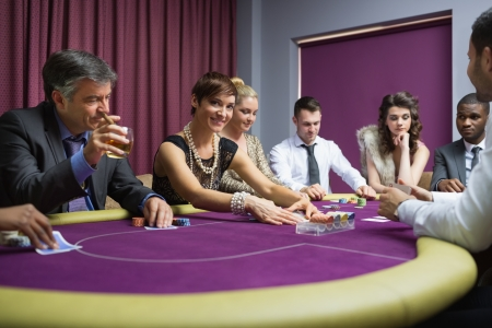Woman looking up from poker game in casino Stock Photo - 16065519