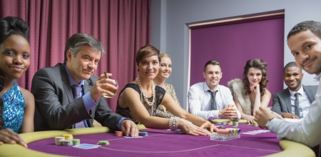 Smiling group at poker table in casino Stock Photo - 16056230