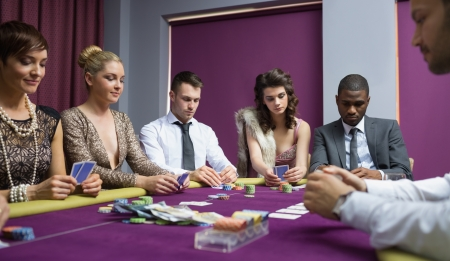 People at the poker table in casino Stock Photo - 16056174