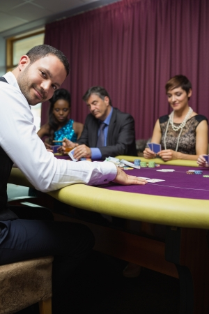 Smiling dealer at poker game in casino Stock Photo - 16056138