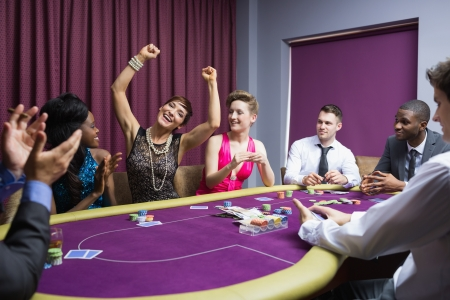 People cheering at poker table photo