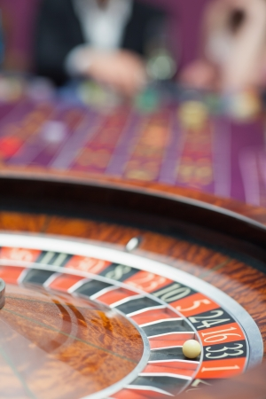 Roulette wheel in motion at casino photo