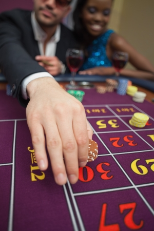 Man placing bet on roulette in casino Stock Photo - 16056724