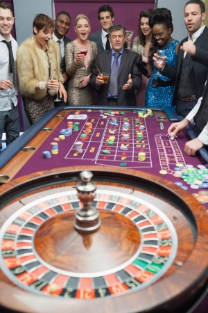 People standing at the roulette table waiting  Stock Photo - 16078806