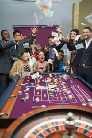 roulette player: People throwing money at the casino