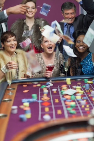 People throwing money while smiling at the casino Stock Photo - 16079532