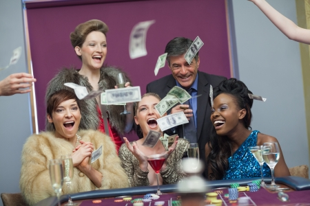 People throwing money having fun at the casino Stock Photo - 16079520
