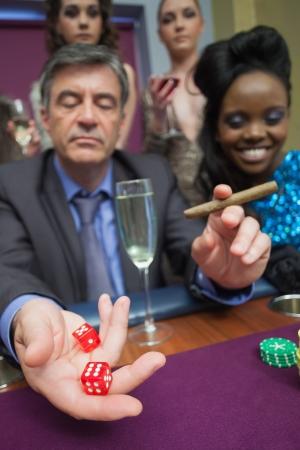Man playing craps in casino Stock Photo - 16078645