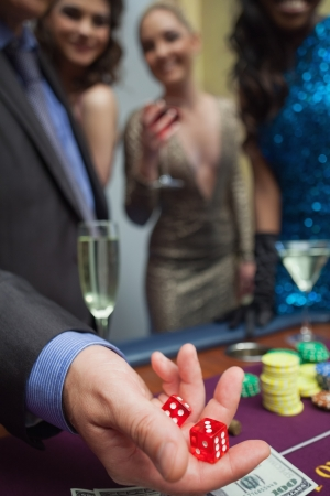 Man is throwing dice at the casino Stock Photo - 16078399