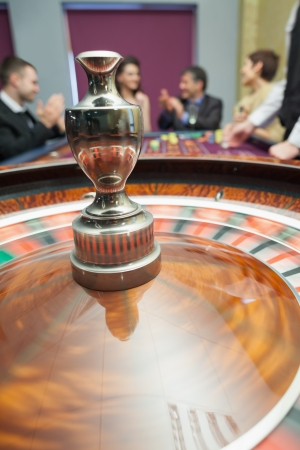 Roulette wheel spinning around in casino Stock Photo - 16066392