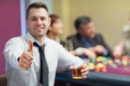 Thumbs up at roulette table in casino Stock Photo - 16065475