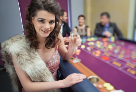 Woman in fur stole a roulette table in casino Stock Photo - 16065476