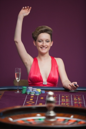 Woman celebrating at roulette in casino  photo
