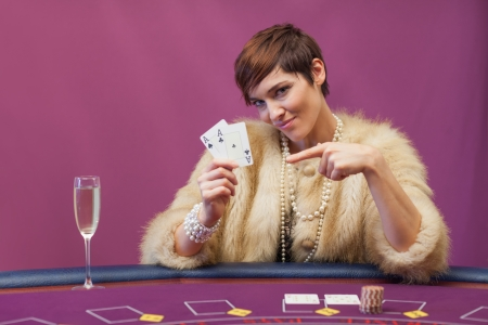 Woman holding up cards in casino Stock Photo - 16068400