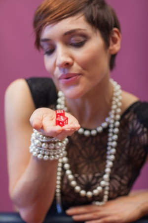 Dice being blown on by woman for luck at casino Stock Photo - 16066791