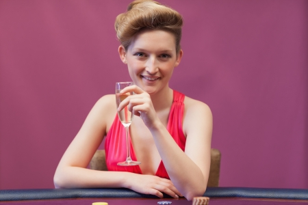 Woman crinking champagne in casino Stock Photo - 16066081
