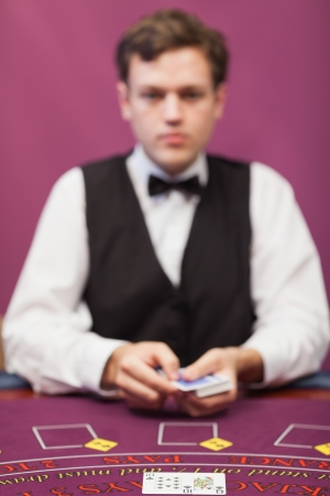deal in: Dealer about to deal in poker game in casino