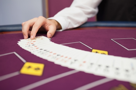 Dealer spreading the deck at poker game in casino Stock Photo - 16055020