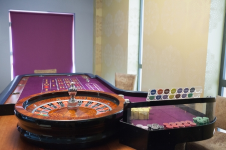 roulette wheel: Roulette table and wheel in casino