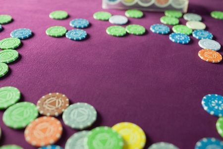 Colorful poker chips lying on tha table in a casino photo