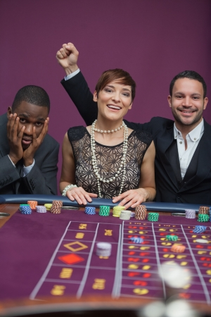 Two winners and a loser at roulette in casino Stock Photo - 16079542