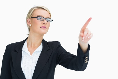Businesswoman pointing in the air Stock Photo - 16051269