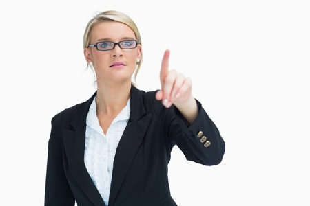 Blonde business woman pointing at something Stock Photo - 16050939