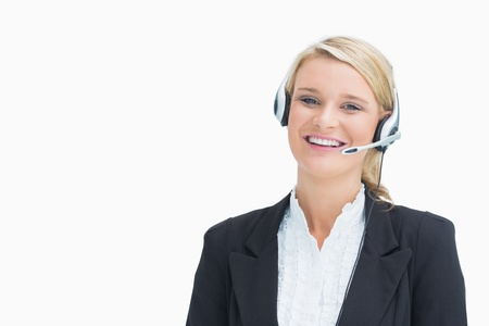 Woman smiling while calling a customer in call centre photo